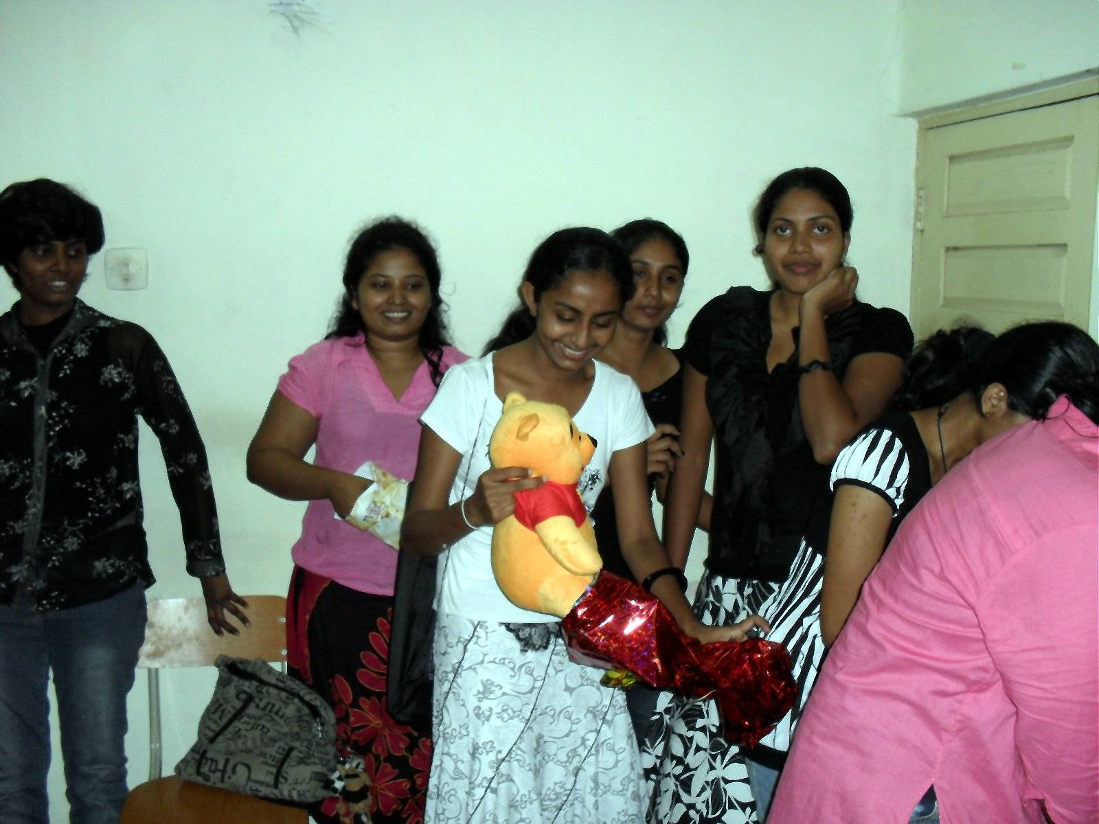 Students are busy with opening their gifts