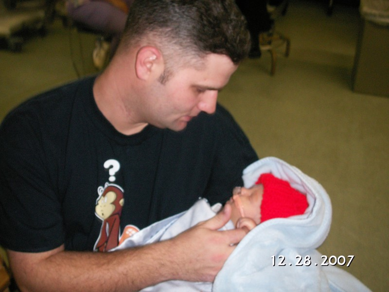 Daddy holding Ben for the first time