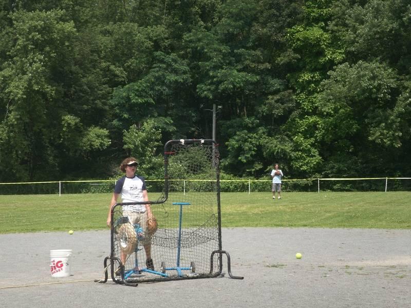 Travis running the pitching machine for the homerun derby