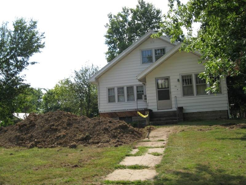 work begins on The Manse's new, raised garage and driveway.