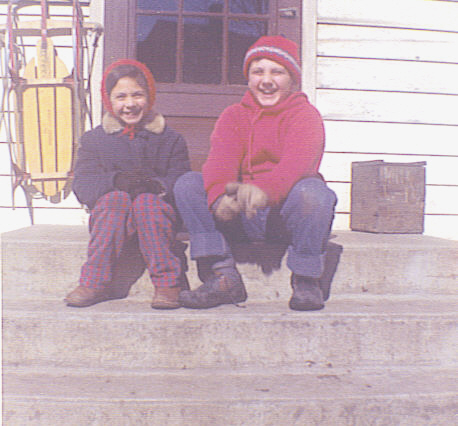 Sara and Marc on back porch in Winter
