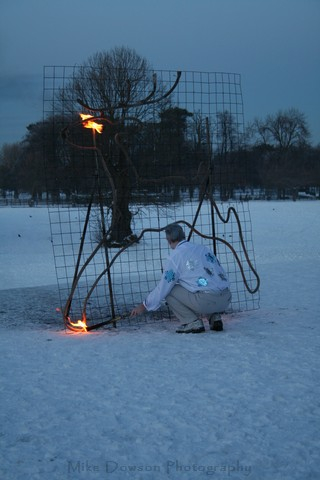 Marko lighting the sculptures
