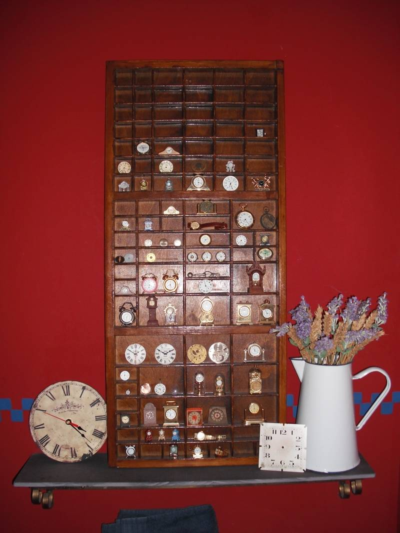 My clock collection in downstairs loo!