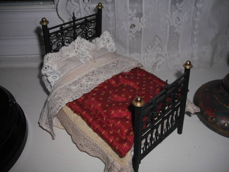 Victorian bed with covers.