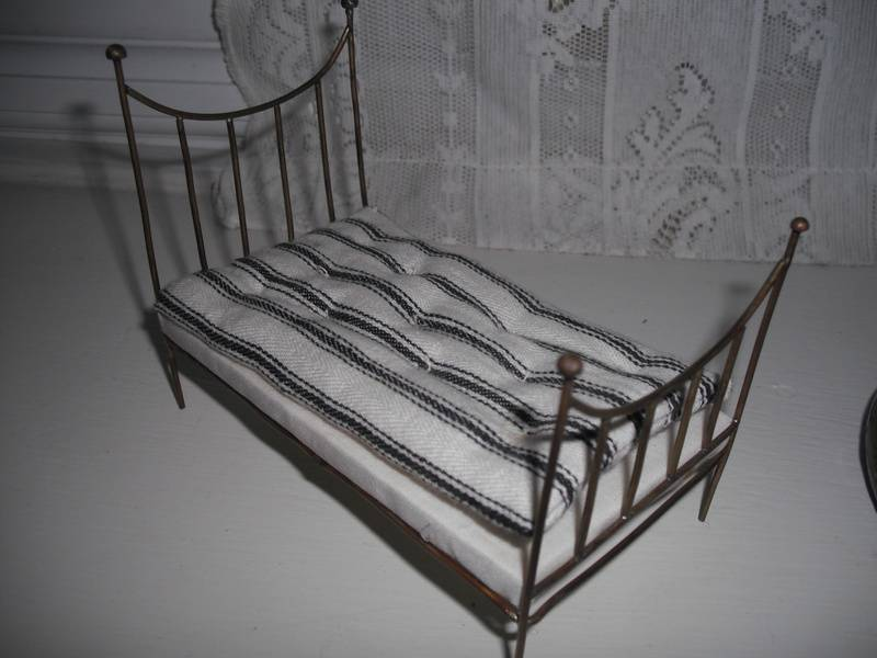 Small brass bed.