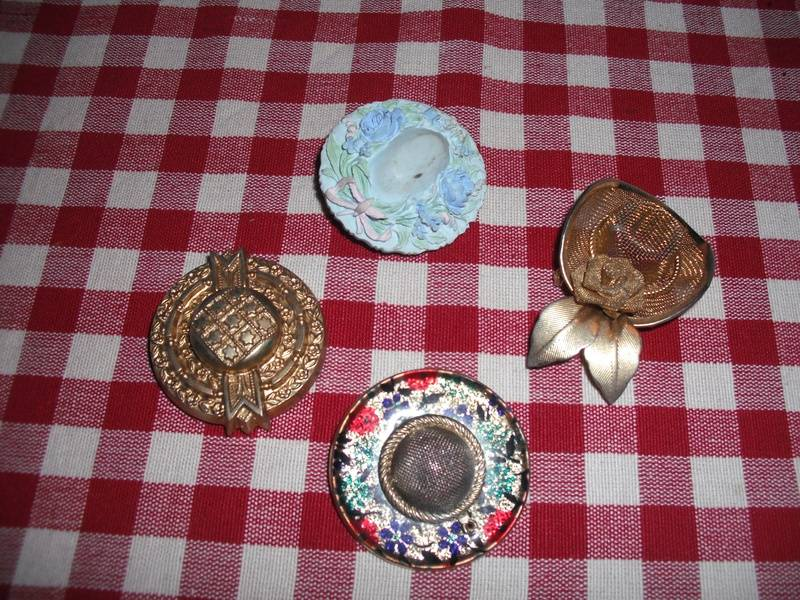 4 hat brooches.
