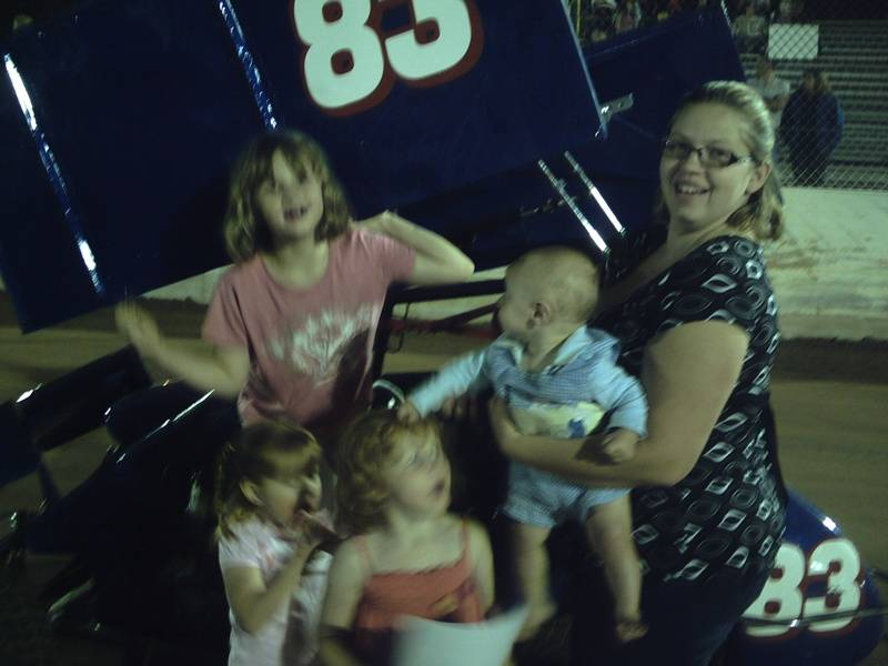 daughter in law, grandkids and maddie with sprint car