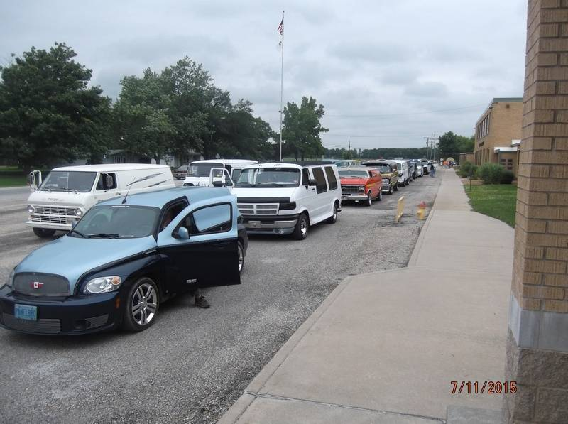 Vans lined up for parade through town