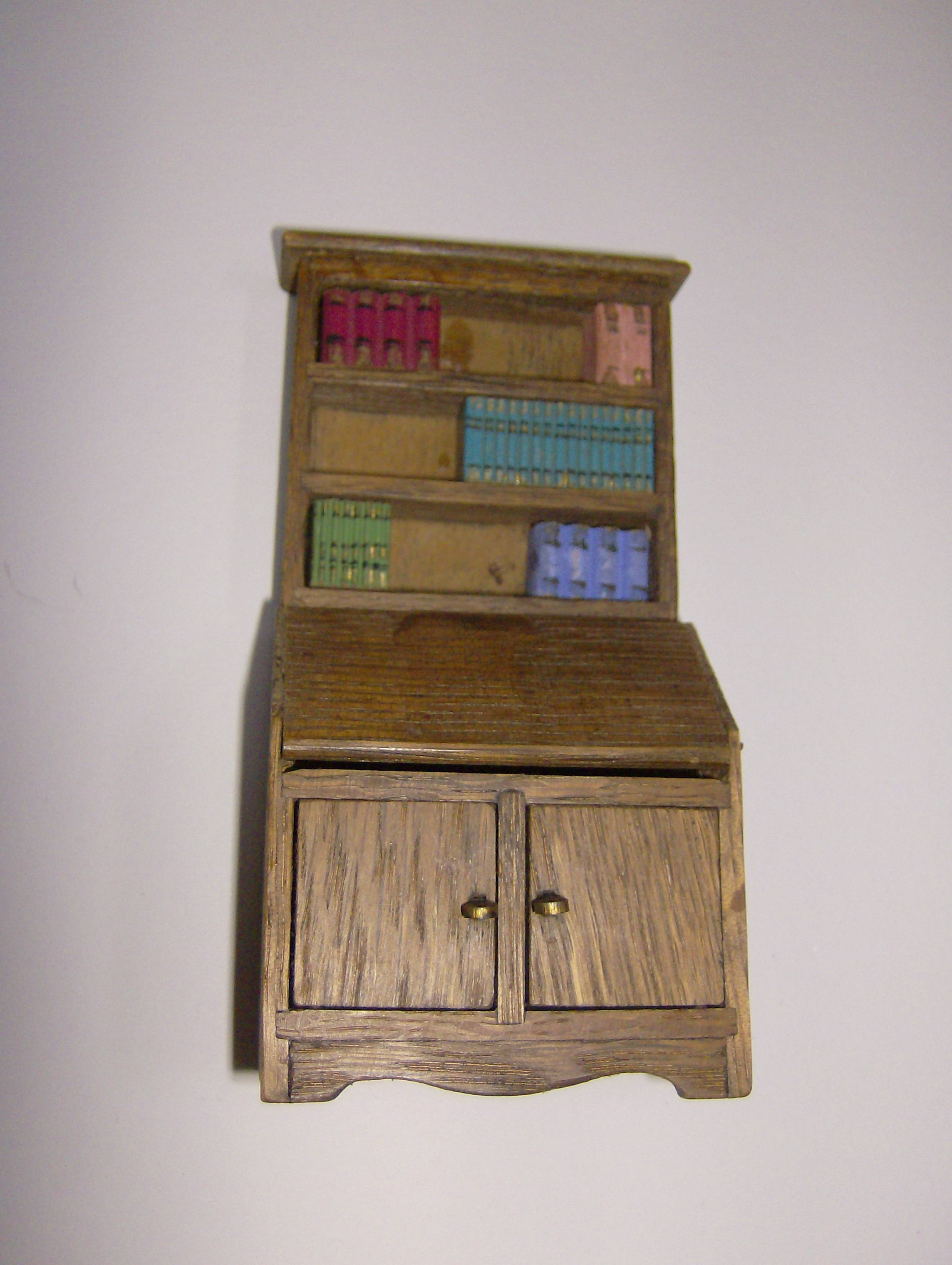 This bookcase bears a strong resemblance to the Basset Lowke one, even down to the books.