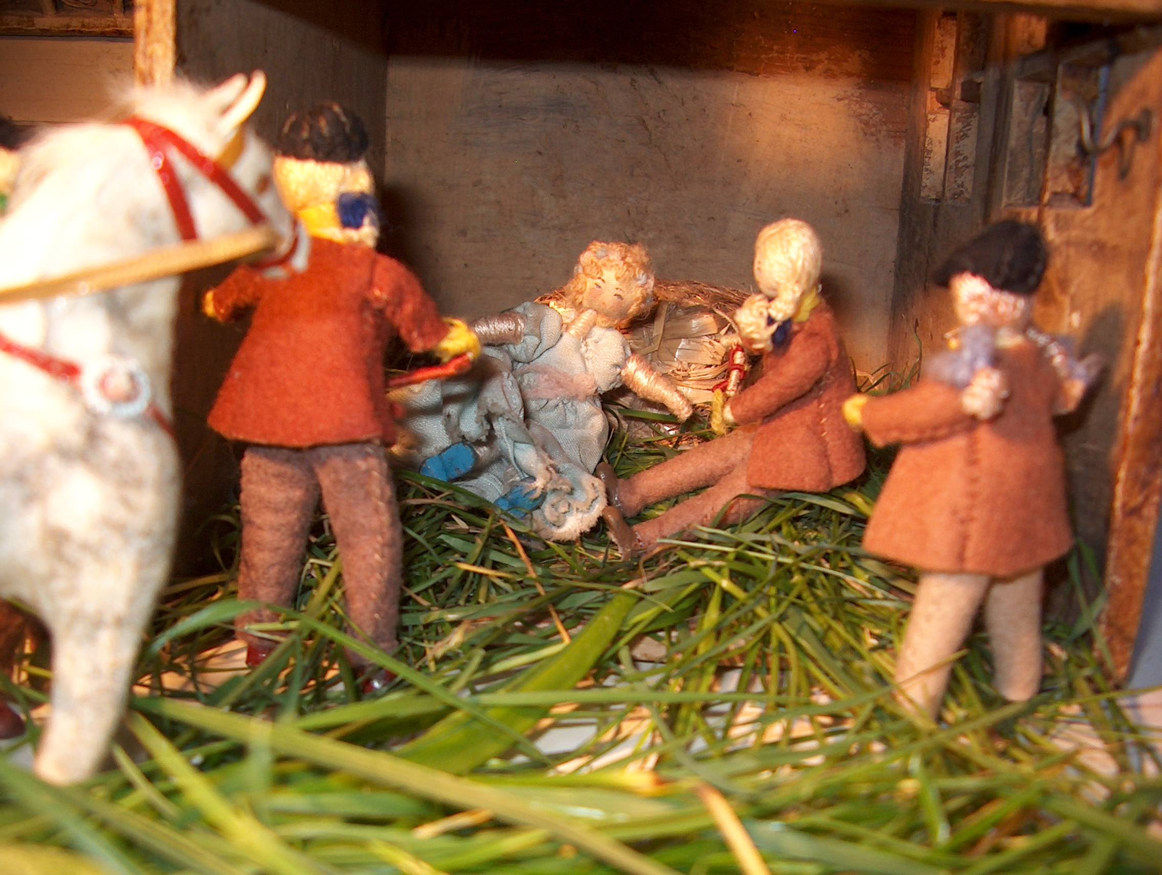 Suddenly, from the pile of hay behind her, there came the sound of coughing and spluttering.