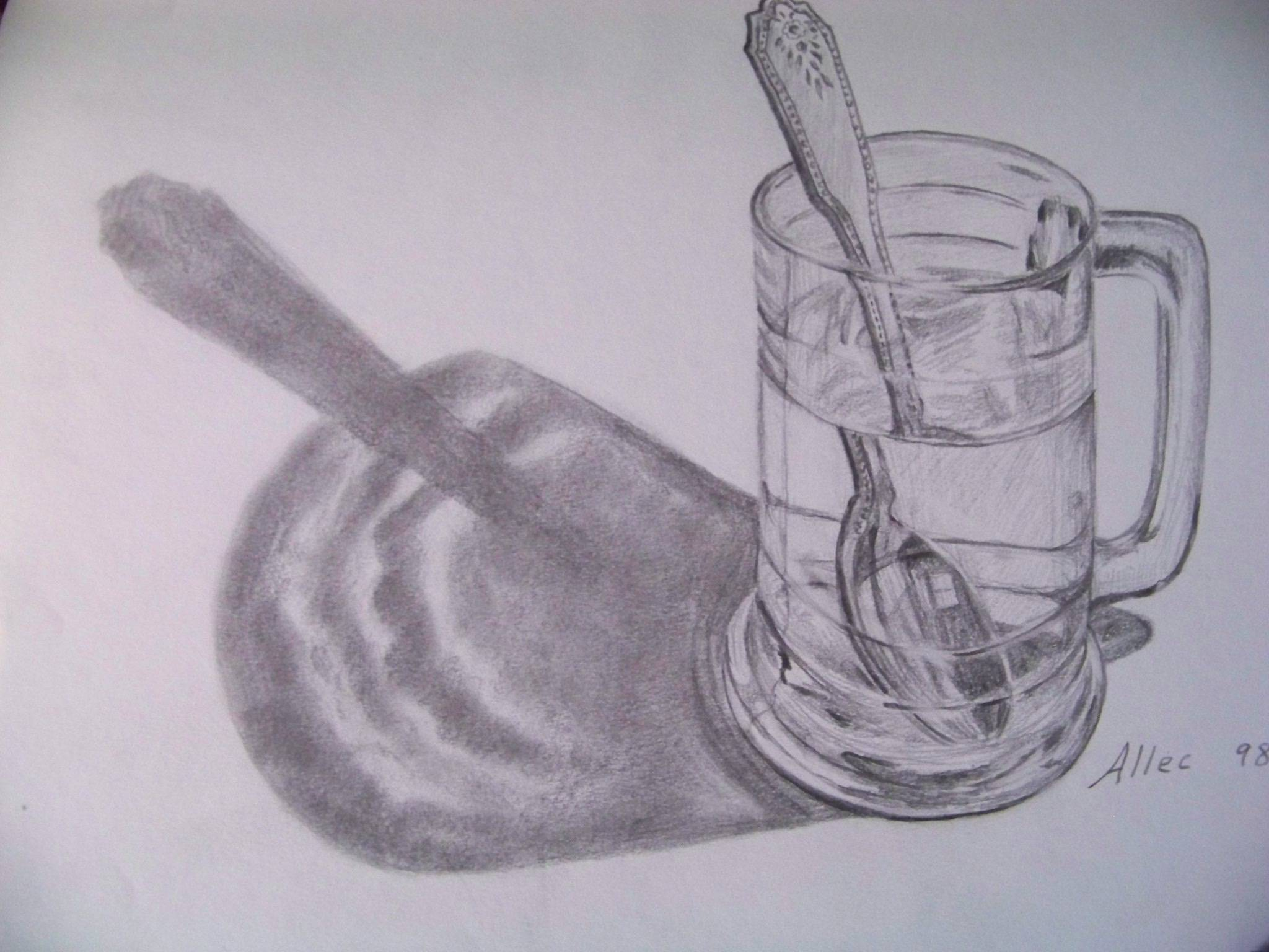 Glass with spoon and shadow