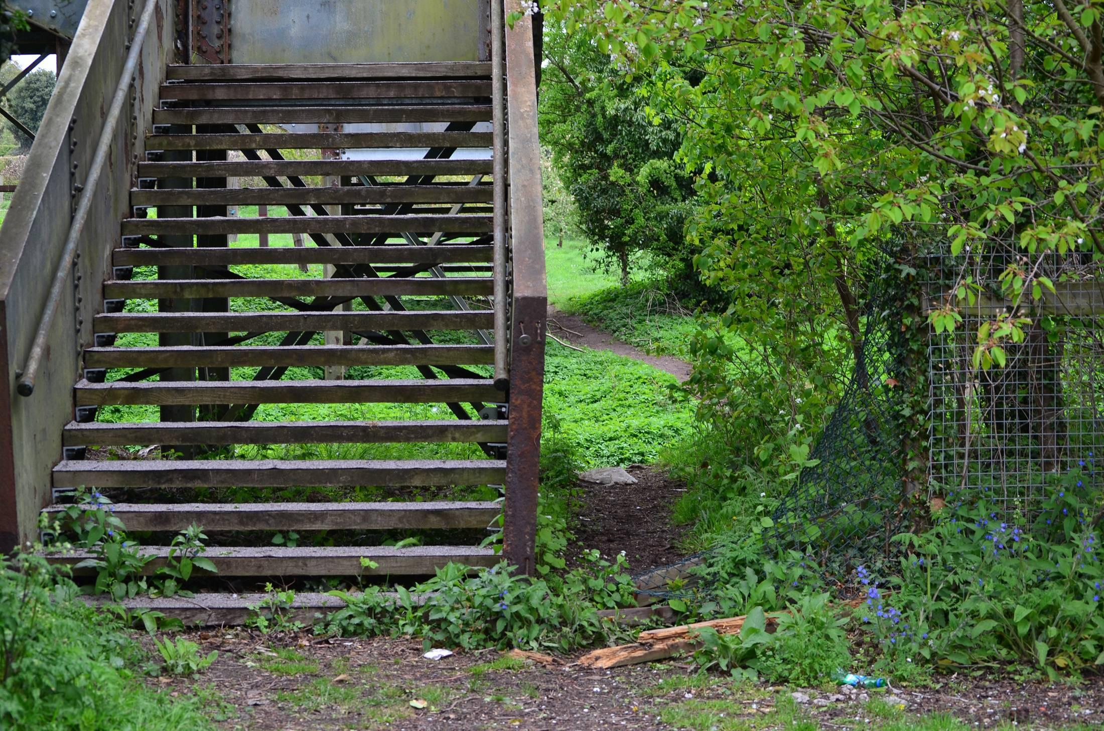 Broken fence on Station road side