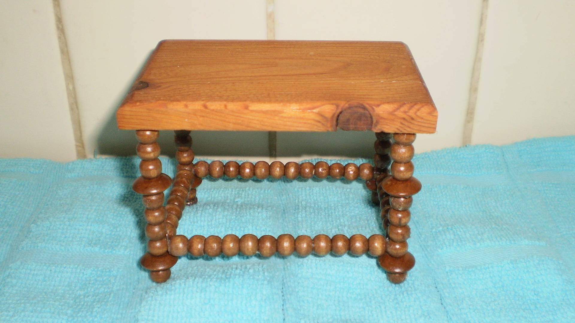 Table legs from wooden beads, top from a horrible table!