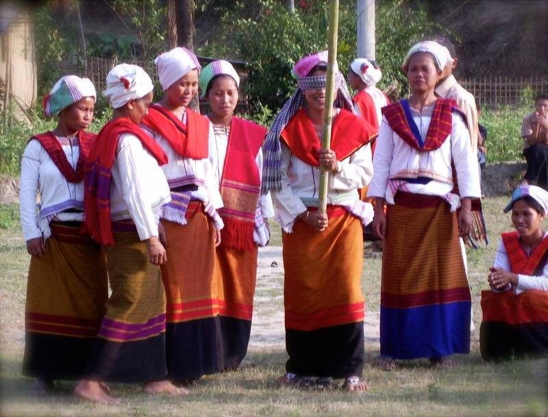 A group of Tanchangya women playing a traditional game