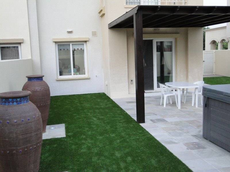 Artificial grass with paving