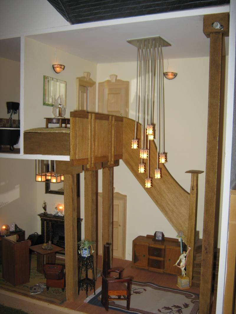 view of waterfall light/stairs/lounge