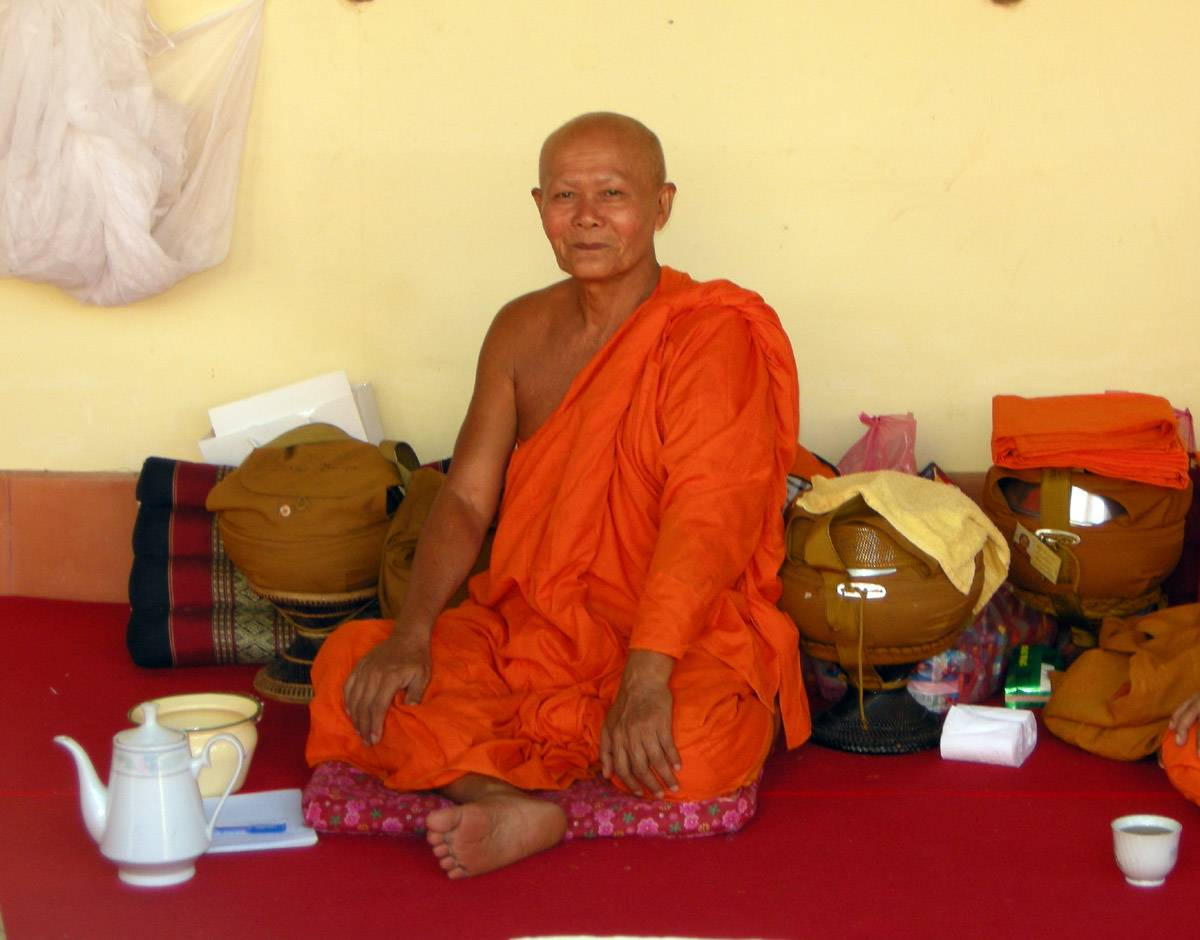 senior monk taking tea