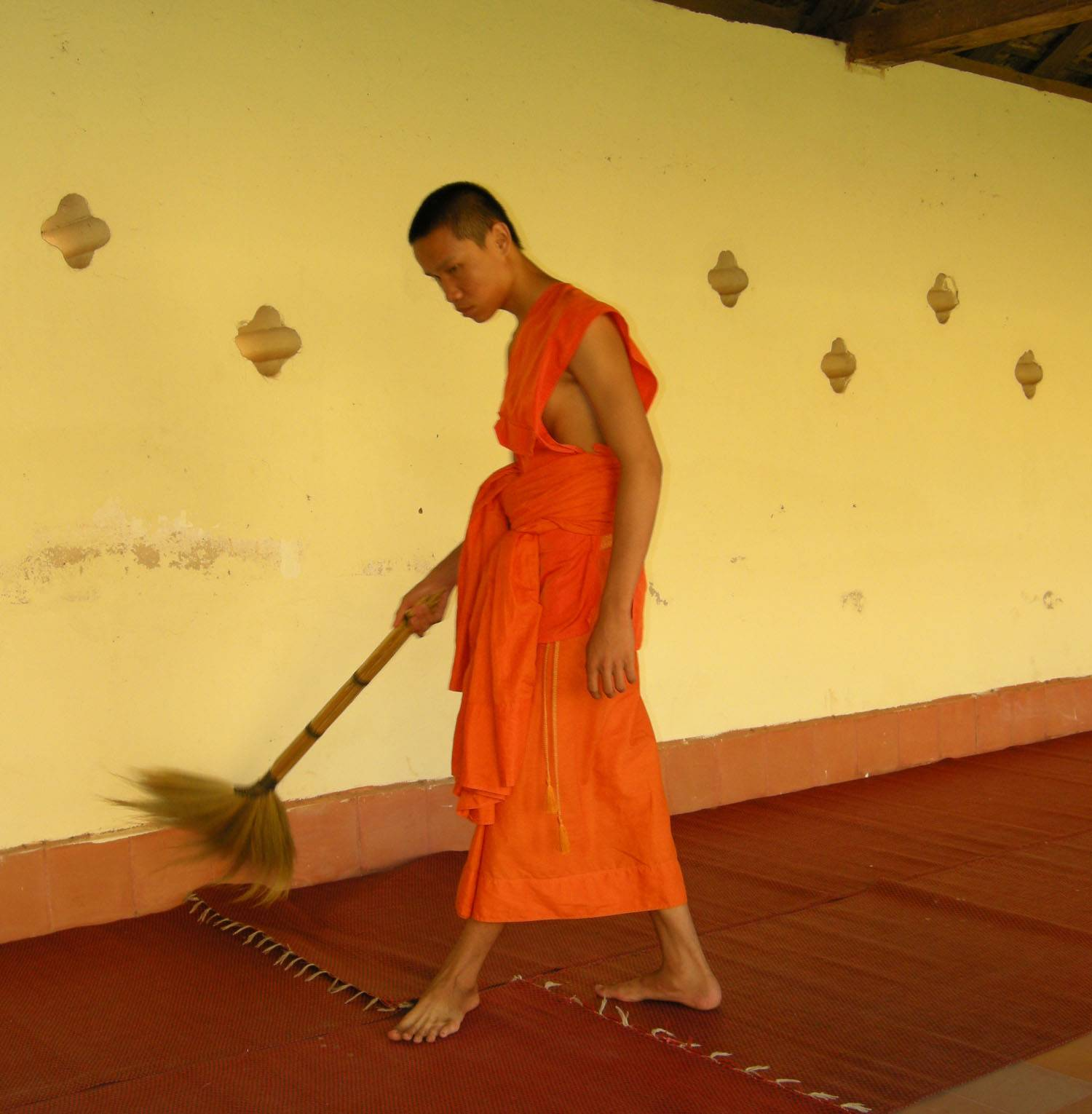 monk cleaning in temple
