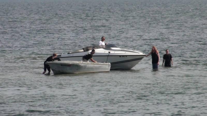 Cigarette boat runs aground.