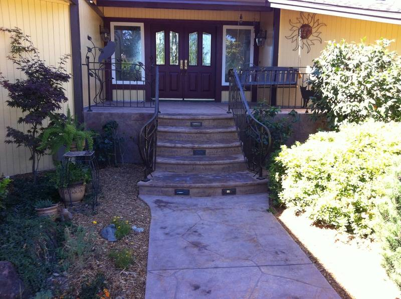 Concrete Porch with Lighted Bullnose Steps and Custom Railing