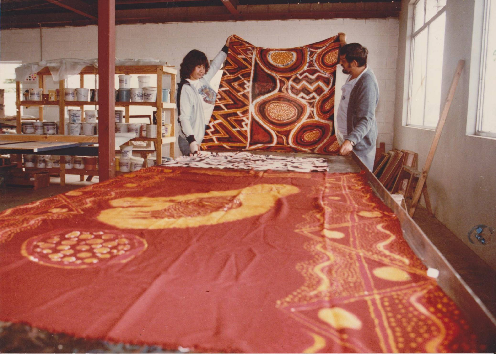 Tom Vudrag with student viewing batiks.
