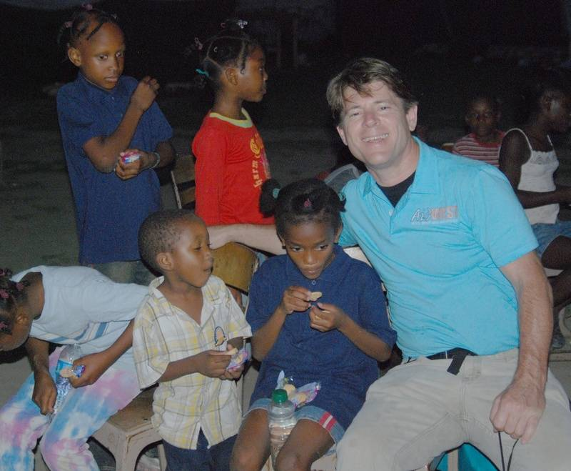 AidWEST Volunteer with Orphans.