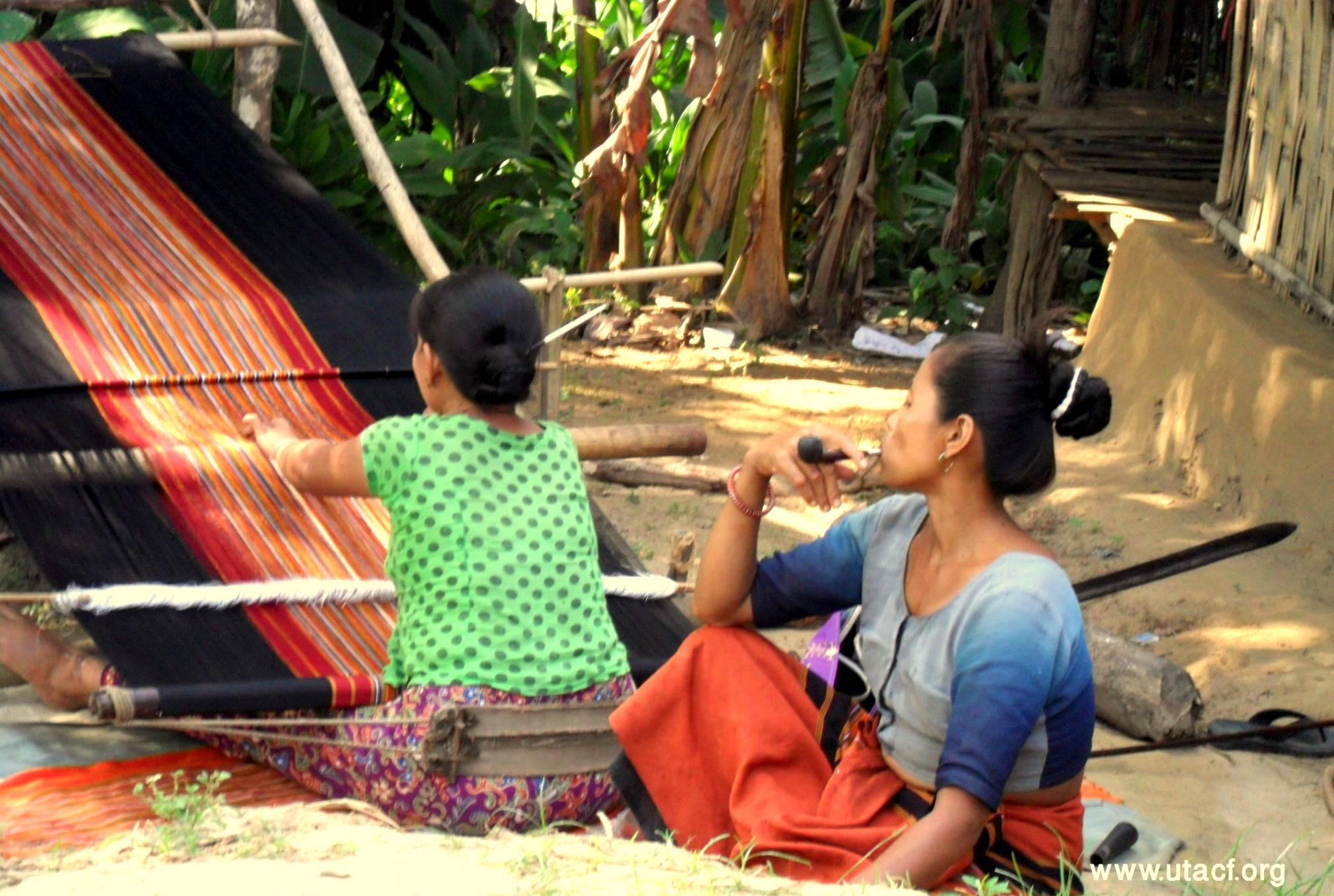 "A Tanchangya woman weaving ""pinoin"", the traditional skirt"