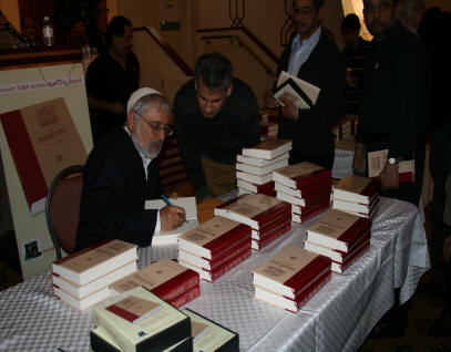 Signing Copies of The Ascendant Quran.