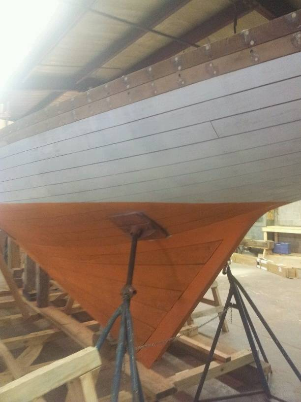 Hull port faired and primed