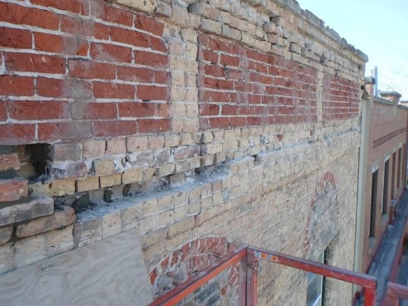 Extensive brick woork at the top.