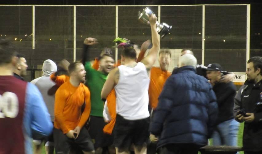 The Trophy is aloft