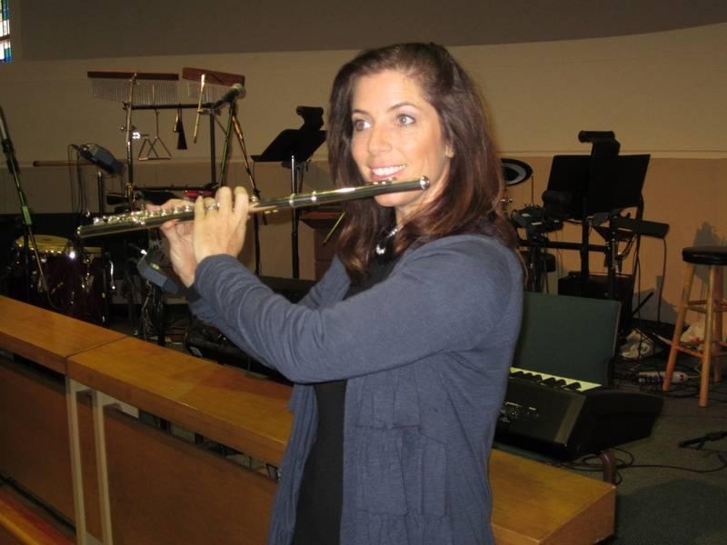 Tambre holding flute