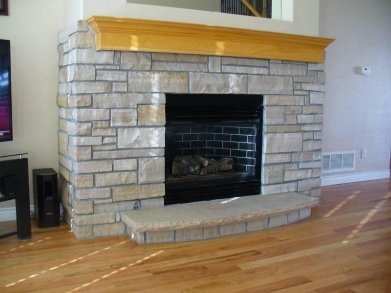 Buff strip thinstone veneer on small fireplace