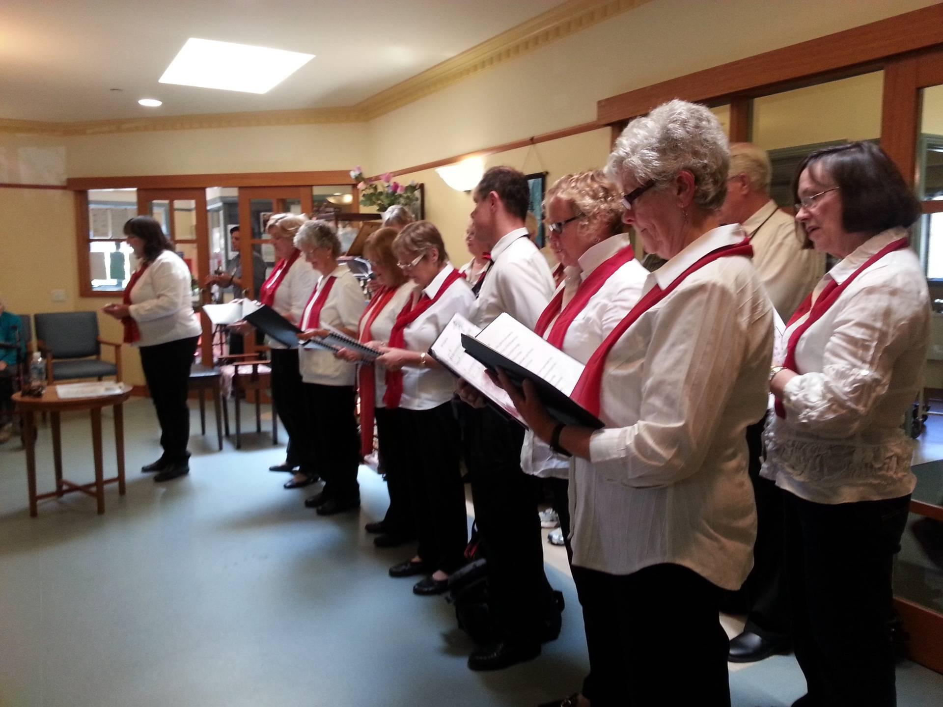 Kerry Clarke conducting  the Whittlesea Township Choir