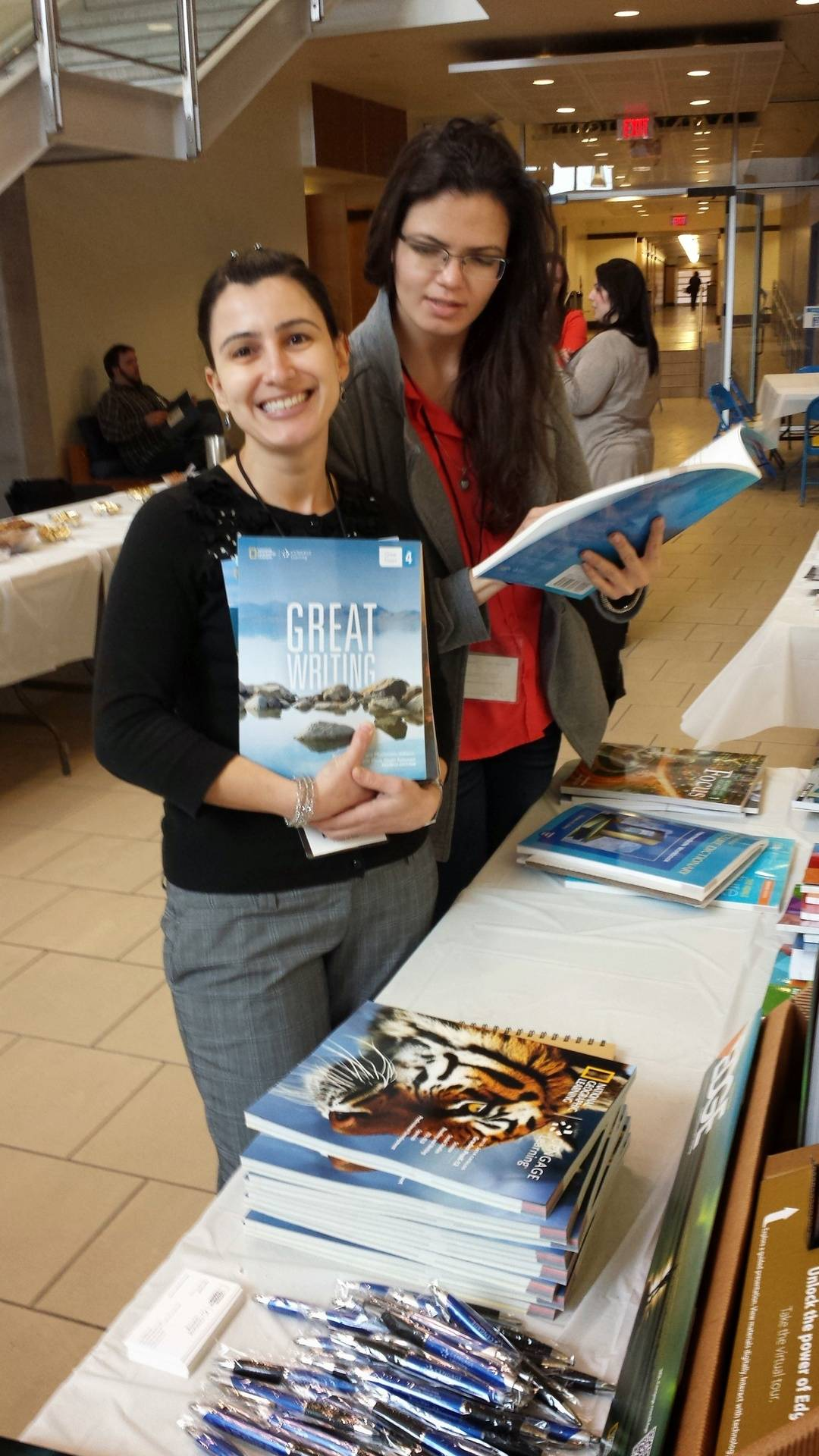 Lindsei and Livia browse publishers' materials