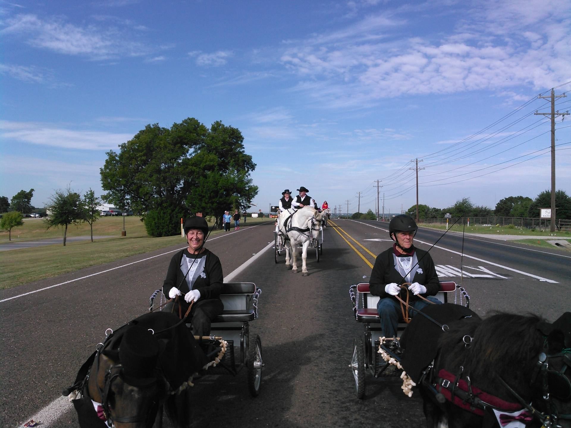 On the road. The carriage horse behind the boys wasn't quite sure what they were.