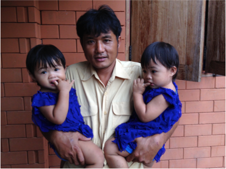 Kae with his twin daughters