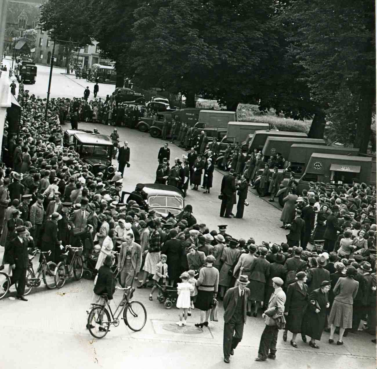 Crowds come to watch Queen Mary with the new YMCA Tea Vans
