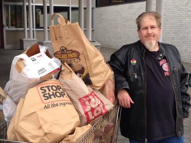 Neil w/food TBT donated to Weth. Food Bank