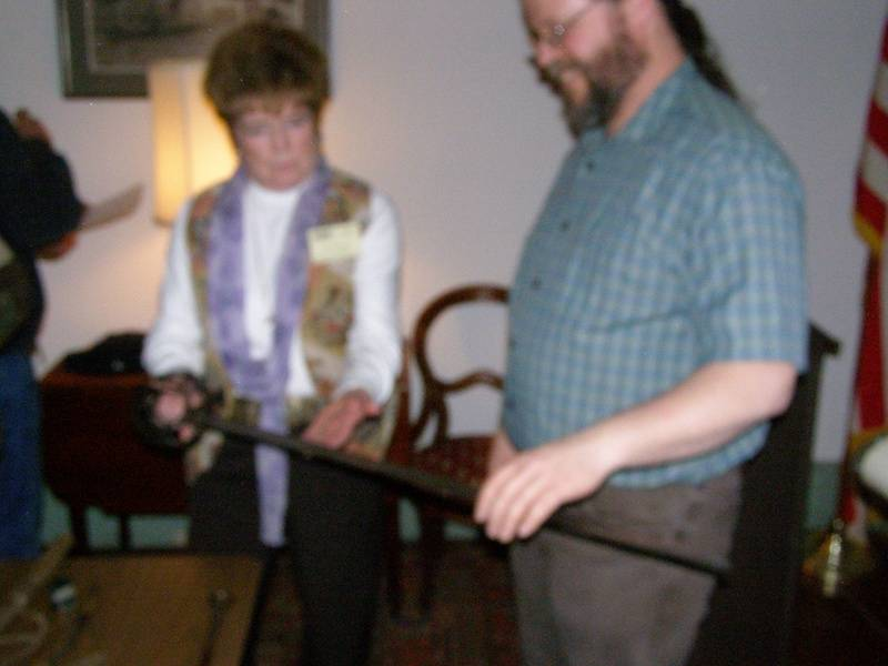 John Ackner shows Alice Begley a sword.