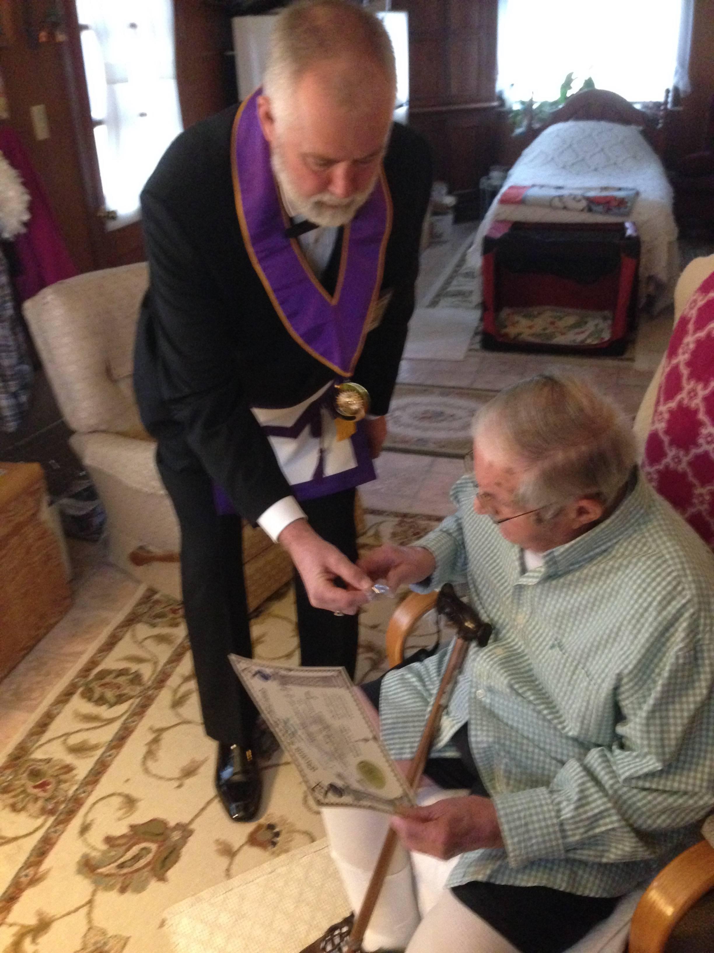 GRAND INSPECTOR PRESENTING 70 YEAR AWARD