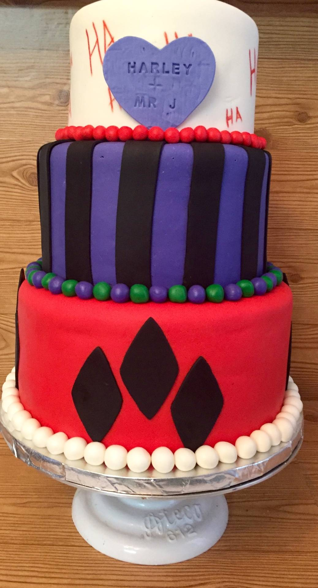 Joker and Harley Quinn themed wedding cake