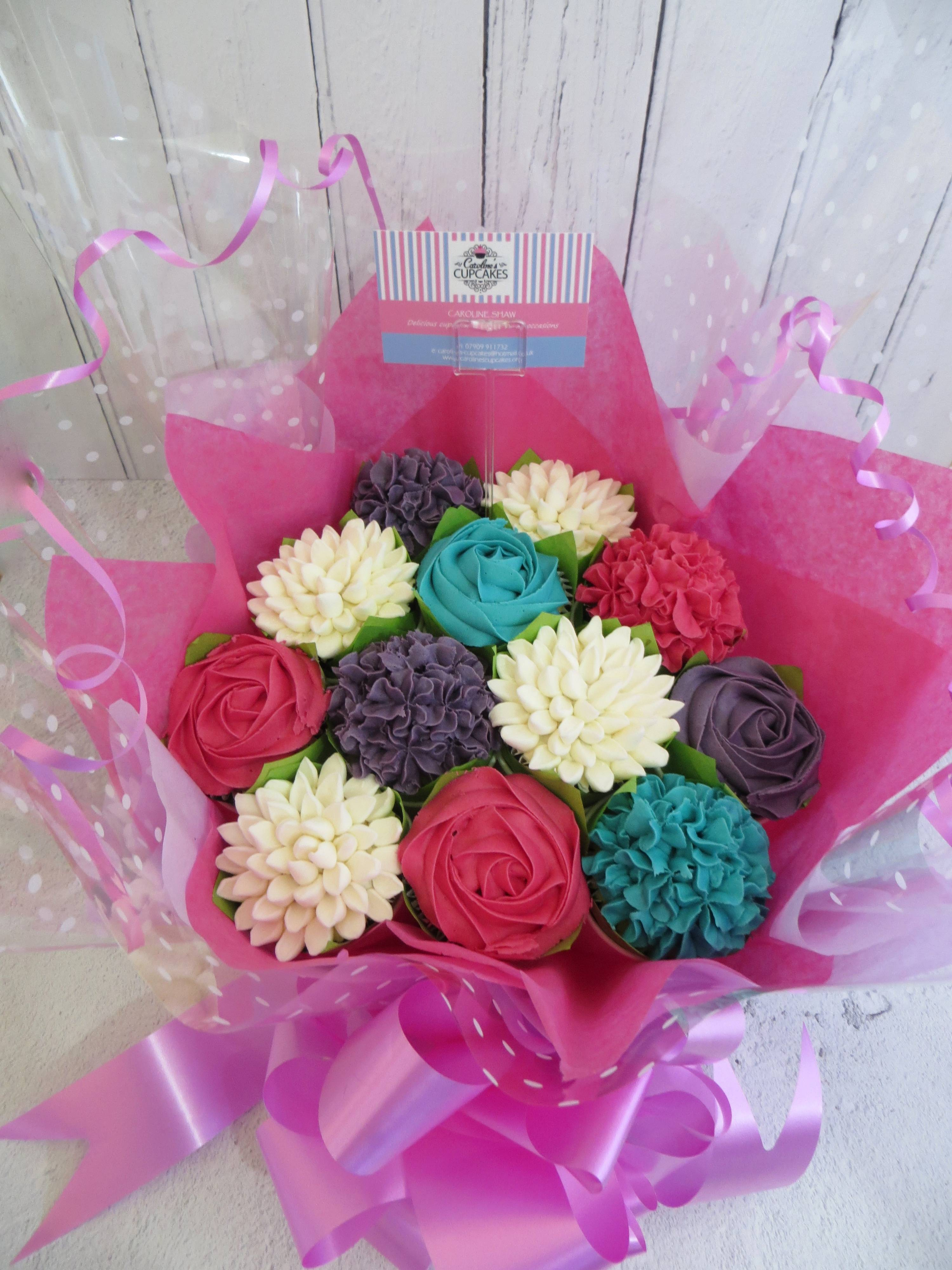 Pink, purple and turquoise cupcake bouquet