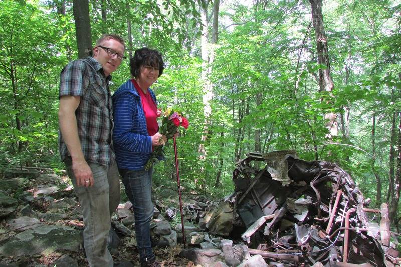 Linda posing with Shane Collins near the wreckage.