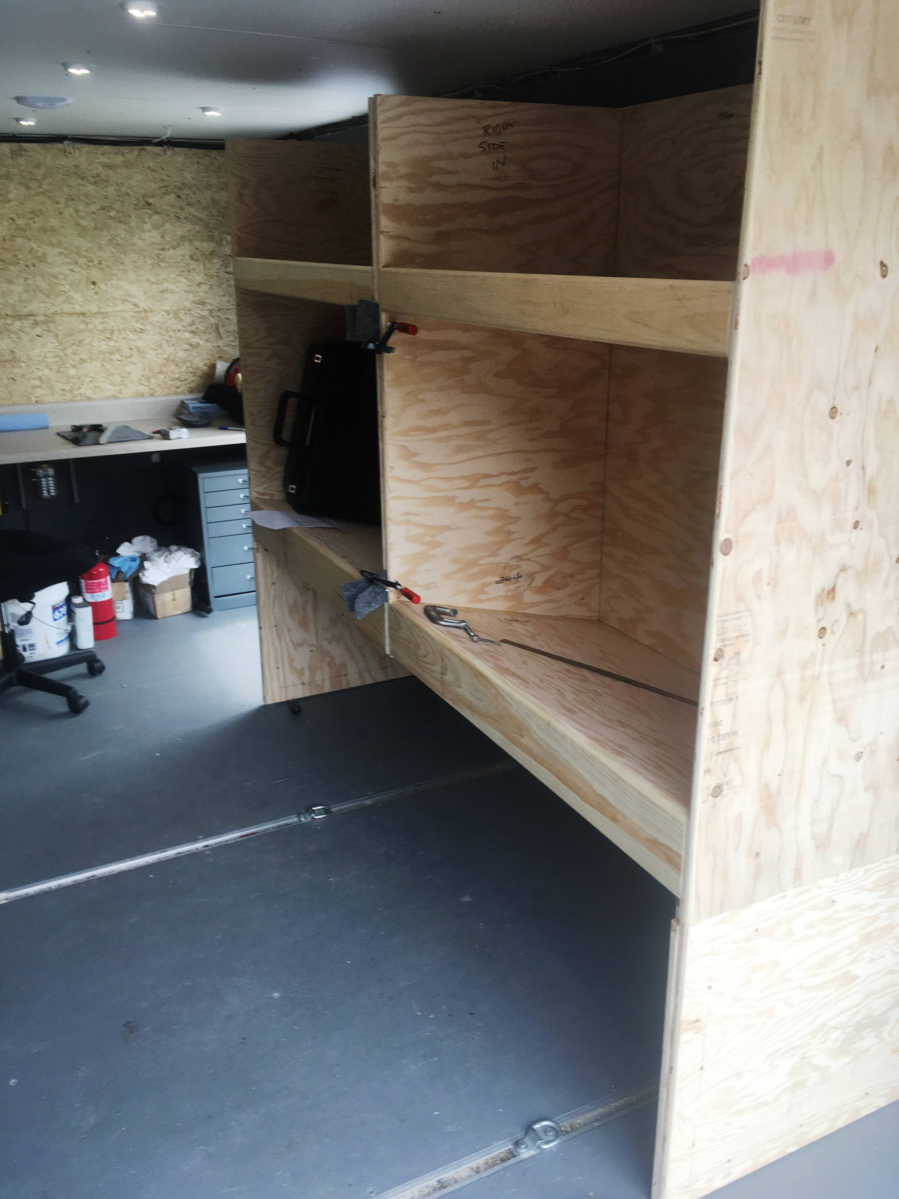 Testing fitting the equipment shelves before carpeting