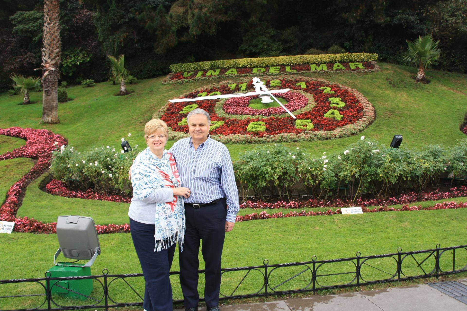 Lynda and Randy with floral clock in Valparaiso, Chili