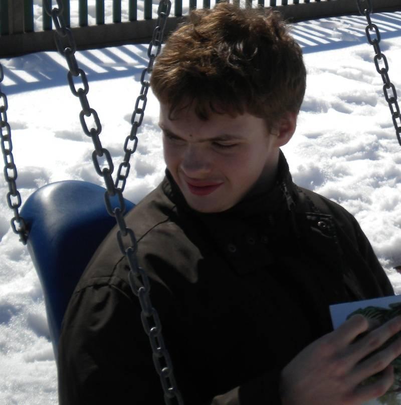 Ben swinging in the snow