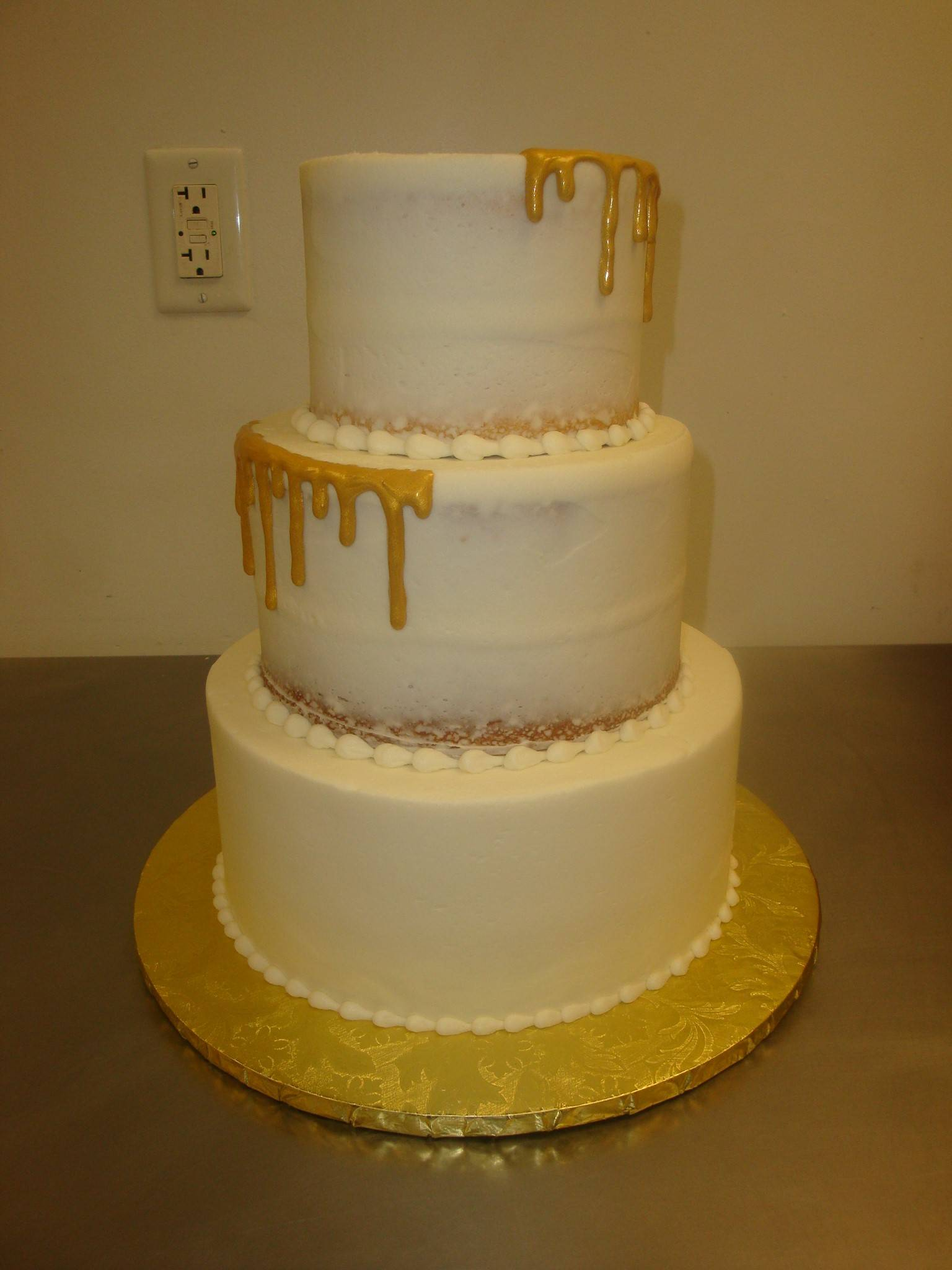 3 tier naked cake with gold drips $150