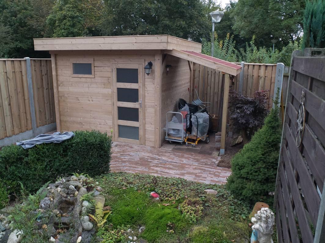 Plaatsen tuinhuis en schutting Wierden