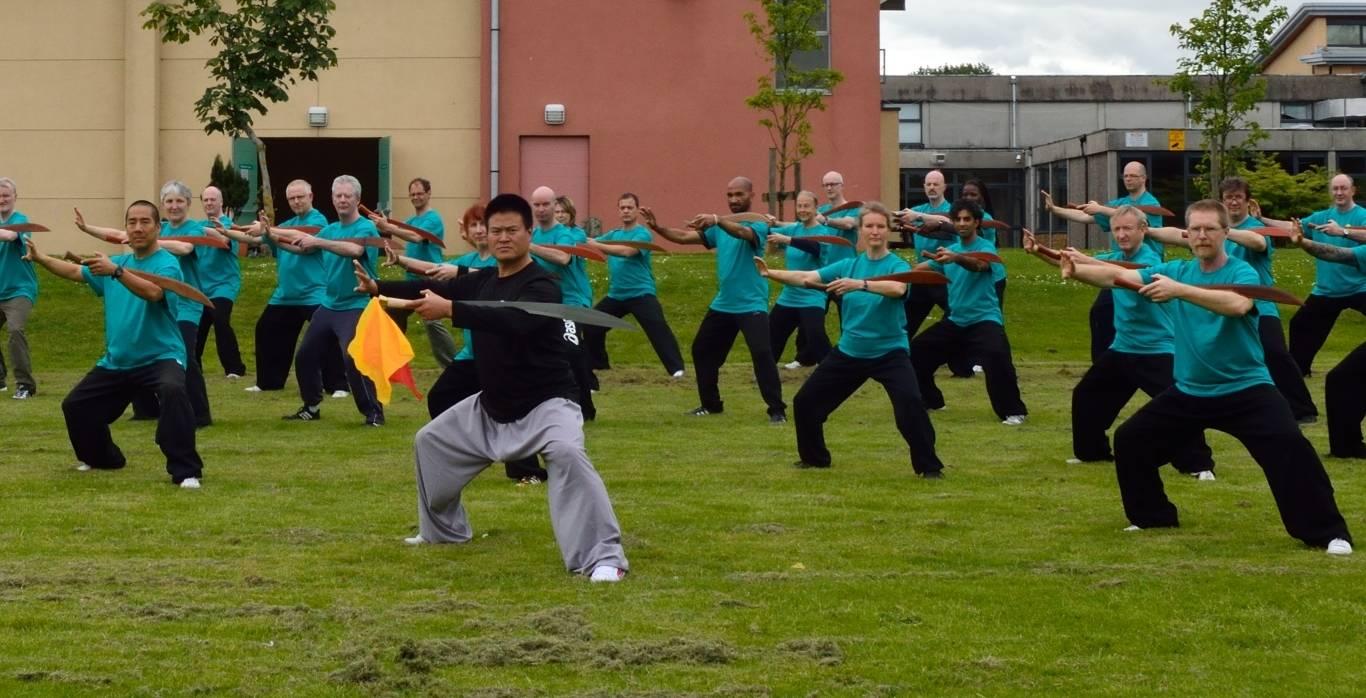 Master Wang Hai Jun leads students in form